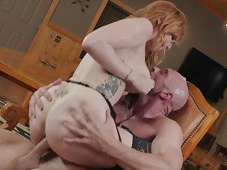 Tattooed redhead Lauren Phillips rides big cock in the cabin