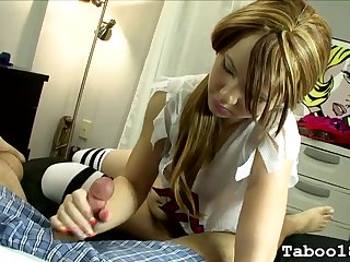 Pigtailed 18 year old gives a handjob in bed