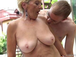 Granny fucks next adjacent to a pool