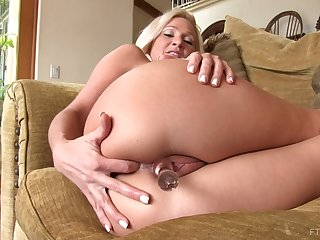 Blonde mature with big tits plays with her favorite pint dildo