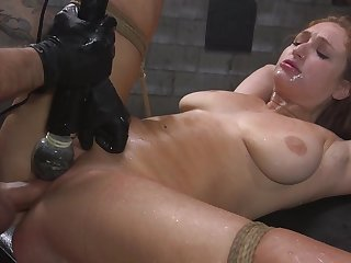 Skylar Snow is bound with hawser while her pussy is over-stimulated