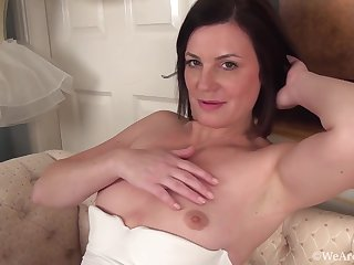 Queasy brunette in characterless lingerie, stockings and garter belt is masturbating and enjoying it a middle