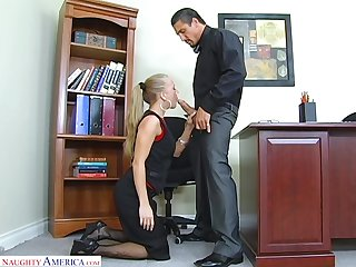 Low-spirited secretary Kylie Wilde gives a blowjob and gets fucked on someone's skin boss's table